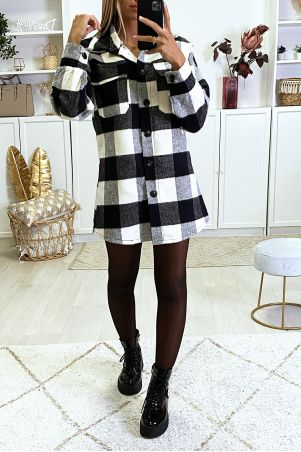 On thick black and white checkered shirt