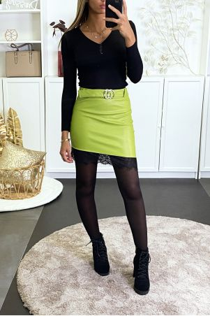 Anise skirt in asymmetrical faux leather with lace at the bottom and belt.