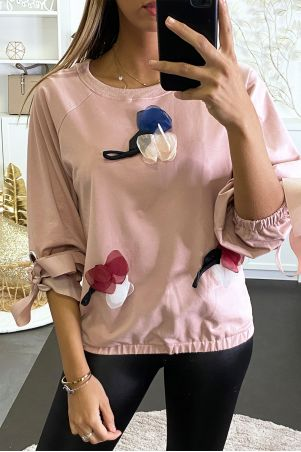 Pink sweatshirt with frilly flower and a pretty ribbon with adjustable sleeves.
