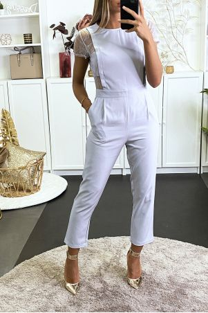 Gray jumpsuit with pockets and lace on the sides