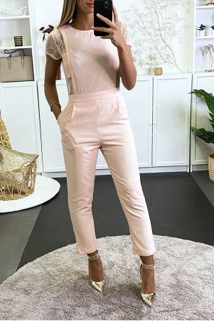 Pink jumpsuit with pockets and lace on the sides