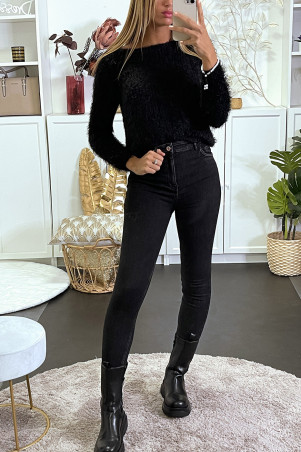 Faded style black slim jeans with a destroyed effect on the pockets.
