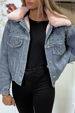 Blue denim jacket with pink faux fur lining and collar