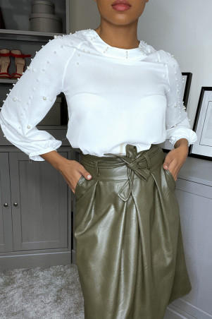 White long-sleeved blouse with pearls