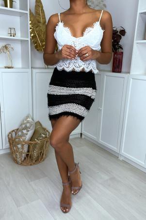 Mini jupe noir et blanc tréssé en simili