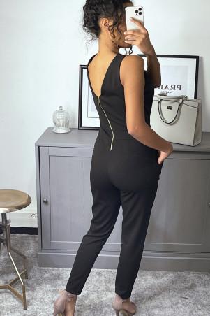 zwarte jumpsuit met zakken en buste opening