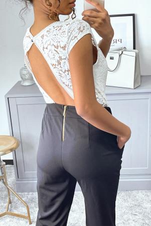 Zwarte jumpsuit met zakken en kanten buste