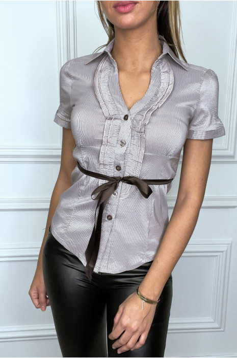 White button-down blouse with frills and ribbon