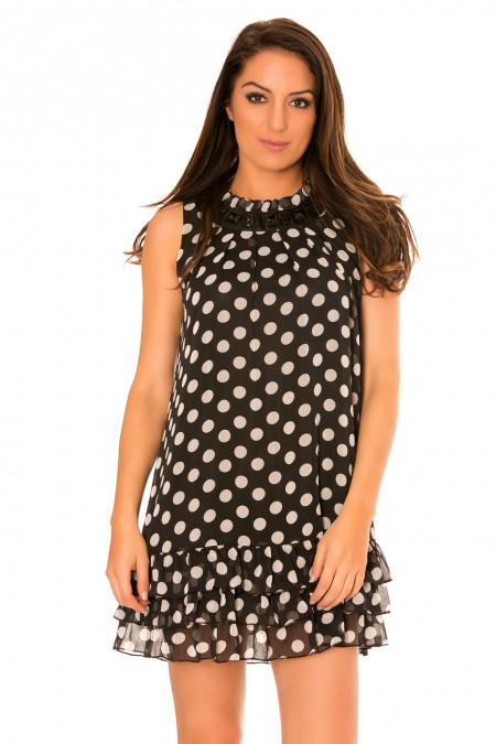 Zwarte doorschijnende jurk met stippen, onderaan geplooid en ronde hals. 959