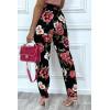 Pantalon fluide noir avec poches et joli motif fleuris très tendance