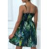 Robe verte froncée à la taille motif fleurs
