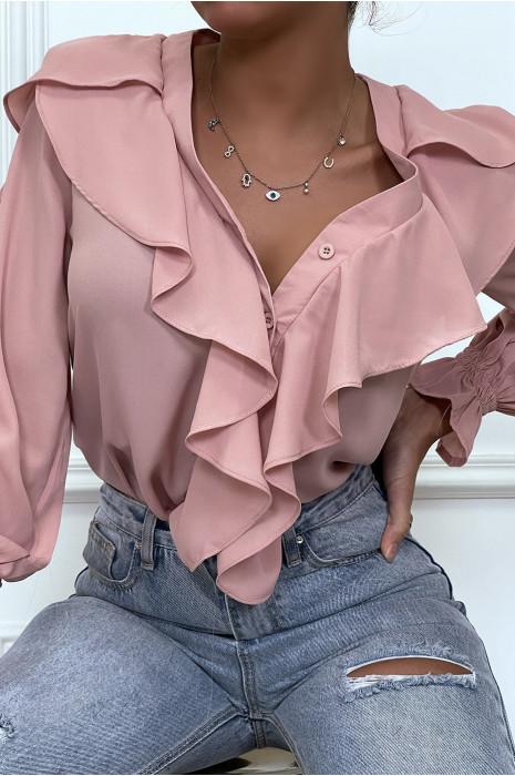Chemise rose pale avec volant à l'avant et aux manches