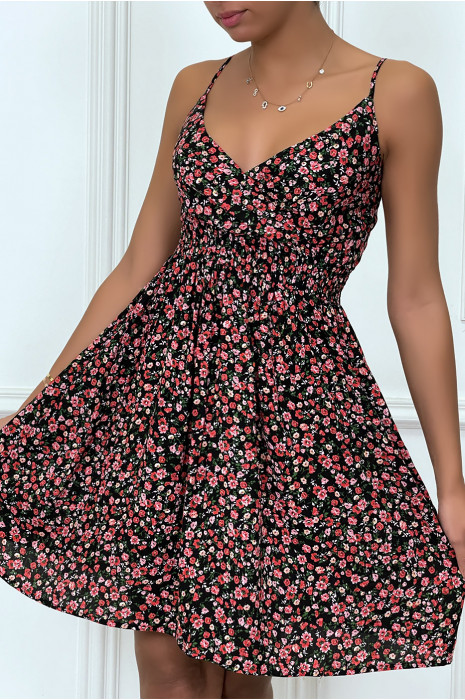 Green dress with flower print at the waist