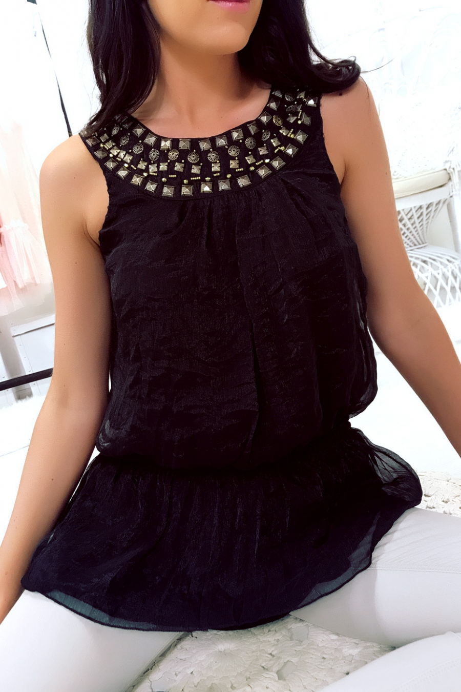 Black blouse with studded collar and elasticated waist. 06512