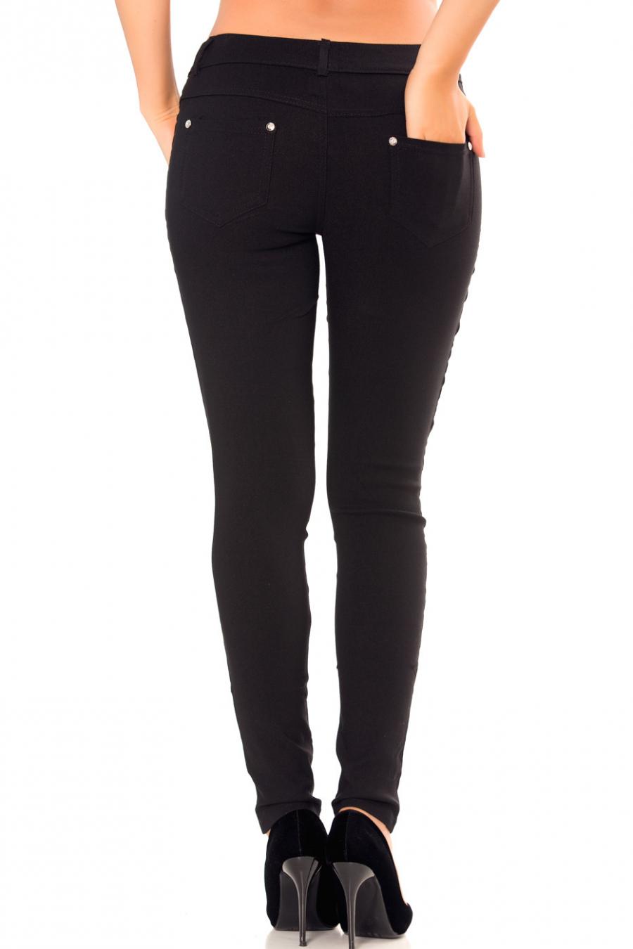 Pantalon slim noir avec poches avant et arrière et boutons style diamant. Enleg 2003.