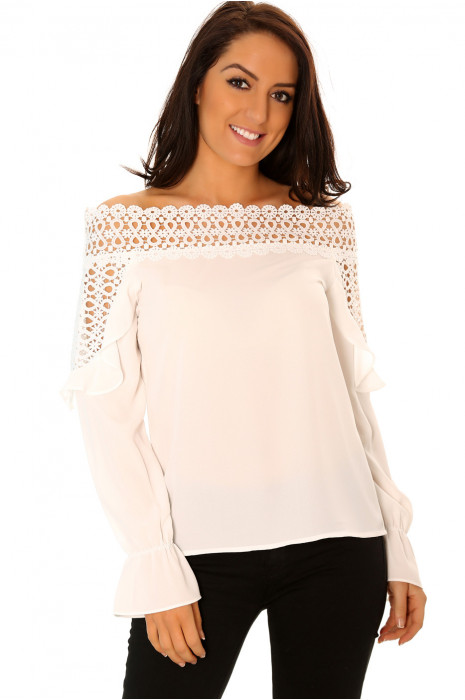 White crochet boat neck top with long sleeves with flared ruffle details.