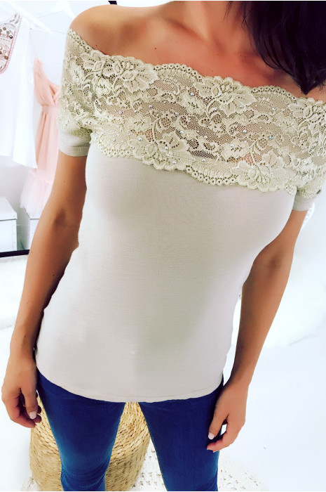 Beautiful beige boat neck top decorated with lace and rhinestones. 1107