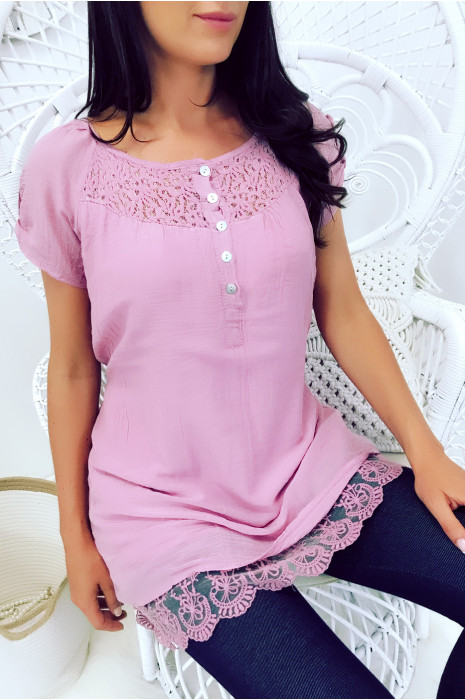 Long pink tunic with buttons and lace details.