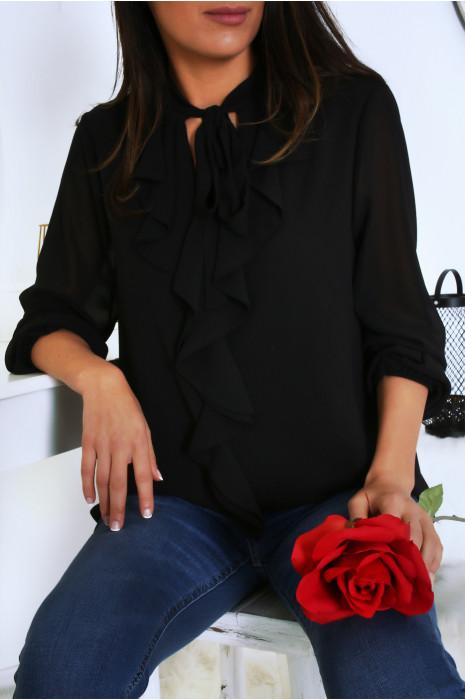 Blouse noir doublé avec volant et noeud. Mode femme