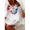 Jolie blouse blanche avec magnifique broderie coloré à l'avant, épaules dénudé