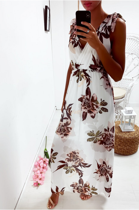Longue robe fleuris en blanc, croisé au buste avec noeud aux épaules