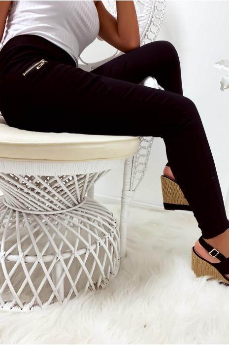 Pantalon slim stretch en noir avec zip et plis à l'avant