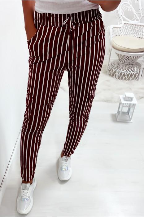 Pantalon jegging rayé bordeaux et blanc avec poches sur les cotés