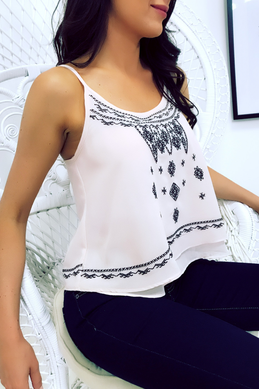 Pink cropped top with thin straps, ruffles and black embroidery. MC1480