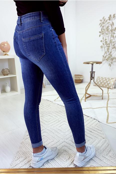 Jeans slim basic délave et légèrement griffé