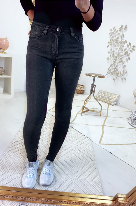 Jeans slim noir délavé très extensible