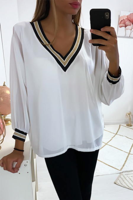 Beautiful white V-neck blouse lined inside, gold at the collar and sleeves. 1844