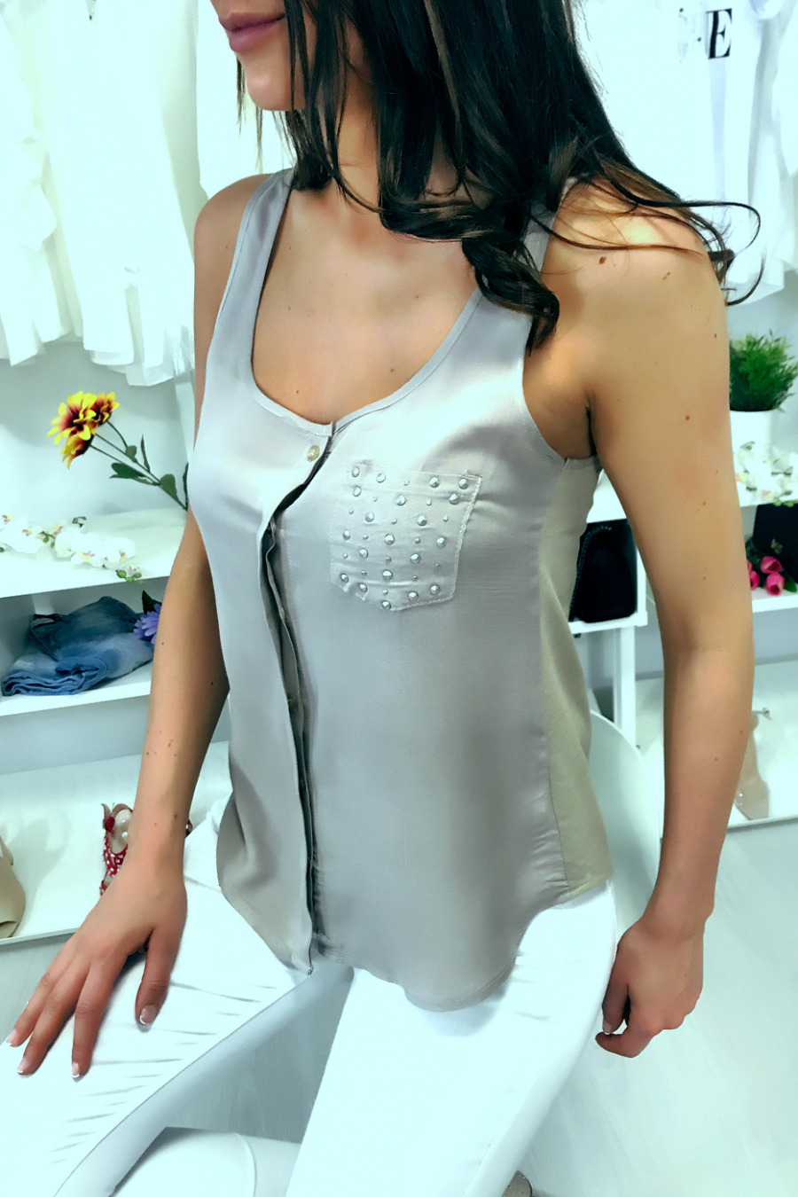 Taupe sleeveless blouse with rhinestone pocket and lace back. F2030