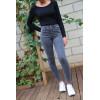Jeans slim noir délavé avec cinq poches, très extensible