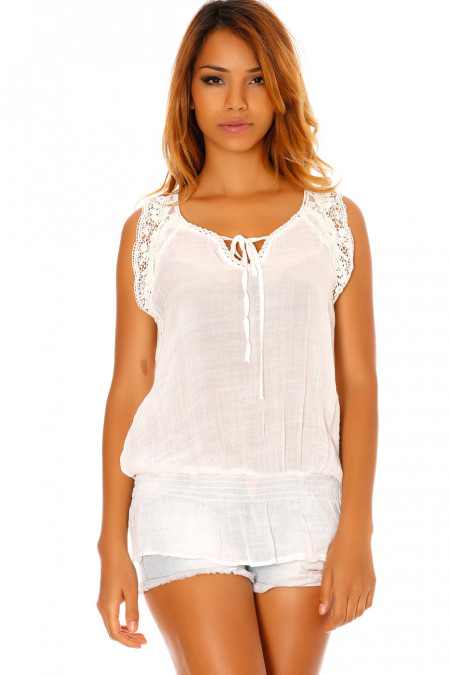 Sleeveless white crepe blouse with lace sleeves. D1117