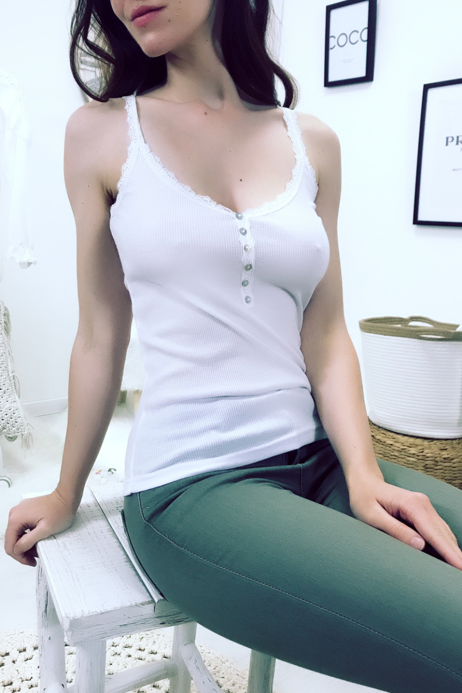 Beautiful white ribbed tank top with lace and buttons.