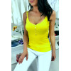Top with thin straps in yellow cotton with lace trims and fancy buttons.