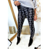 Black winter leggings with panther head patterns in white. Fashion style.