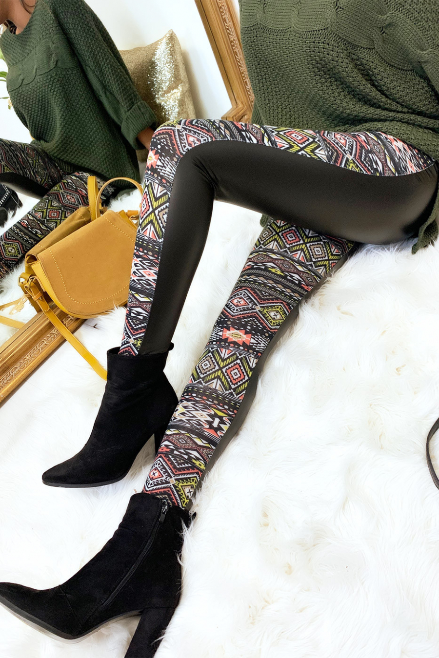 Winter leggings colored in yellow and black, fancy patterns and sky behind. Fashion style. 148-3