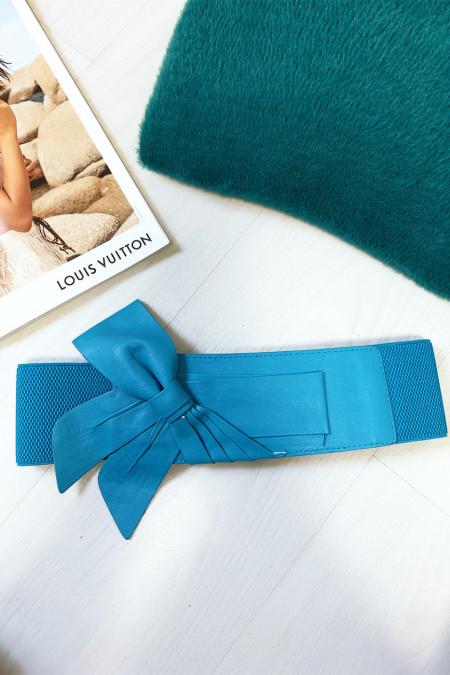 Mooie turquoise riem in vlindervorm, verkocht in verpakkingen van 12