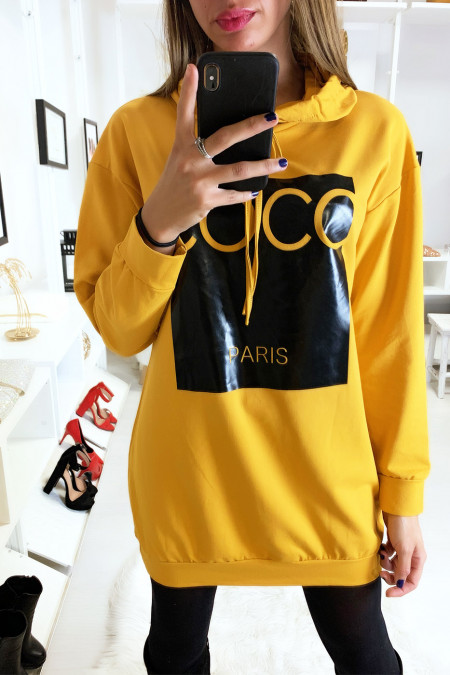 Mustard hoodie with coconut writing on shiny background