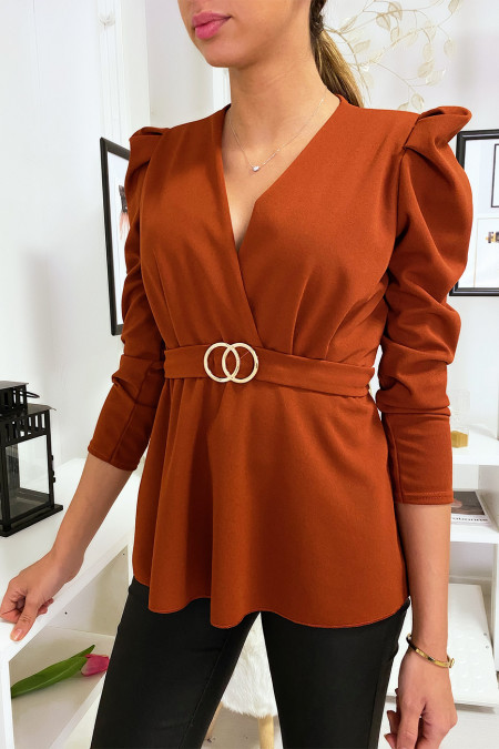 Cognac Peplum top with golden buckle on the belt.