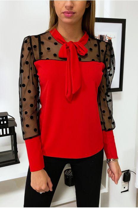 Blouse rouge avec buste et manches noires transparentes à pois