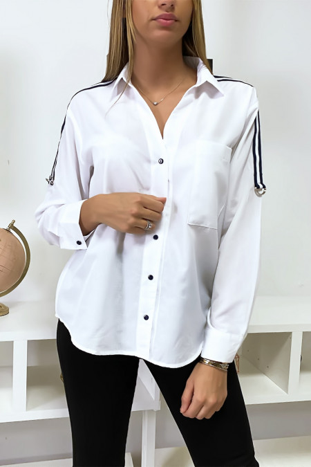 White shirt with striped band on shoulders.