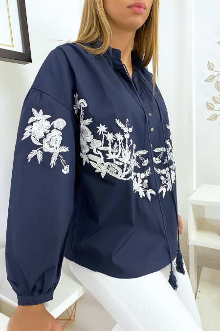 Navy blouse with white flower and string