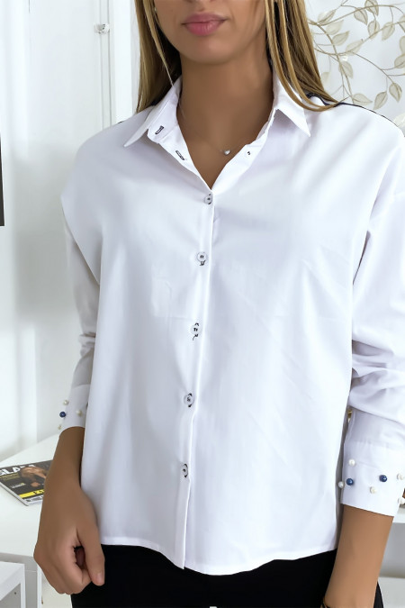 White shirt with pearls on the sleeves