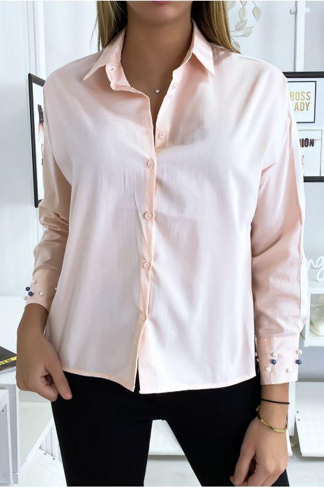 Chemise rose à perles sur les manches