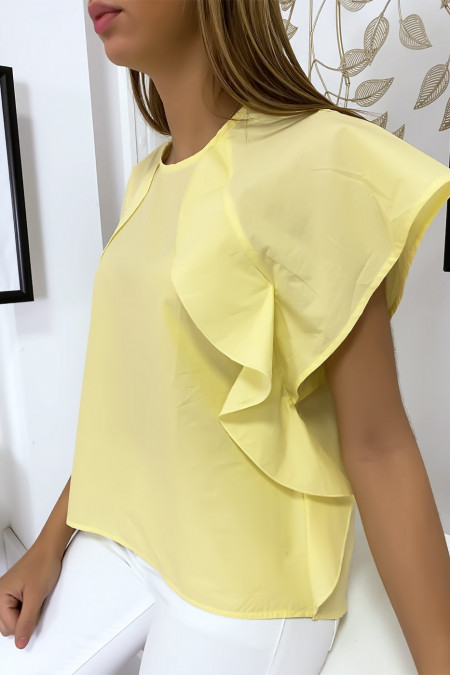 Yellow blouse with ruffle and three buttons on the shoulders