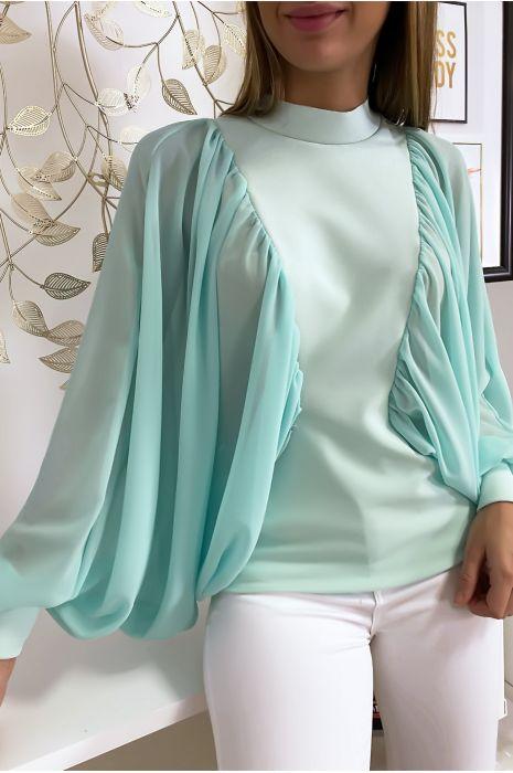 Turquoise blouse van twee materialen met wijde crêpe mouwen
