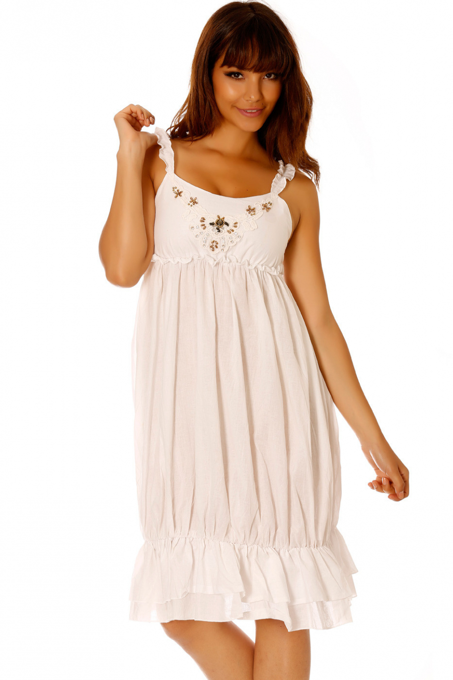 White dress with strap and accessory on the chest. Female SM758