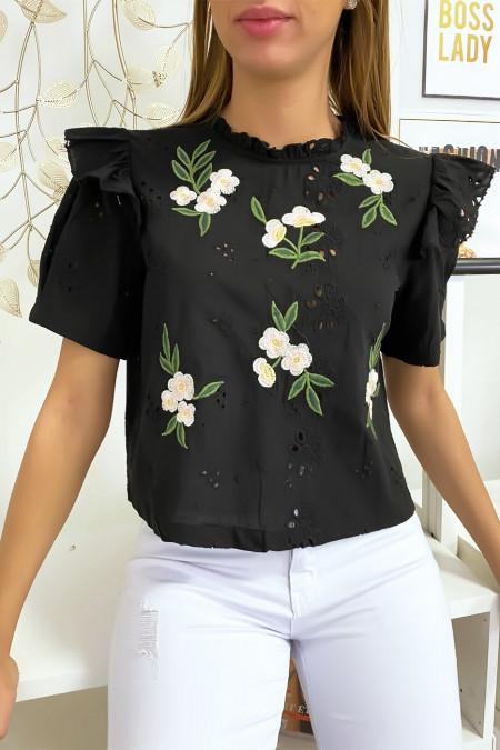 Zwarte blouse met mooie bloemenborduursels en strik op de rug